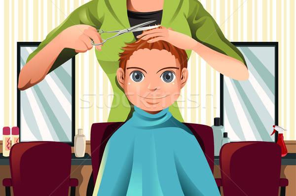 Boy getting a haircut Stock photo © artisticco