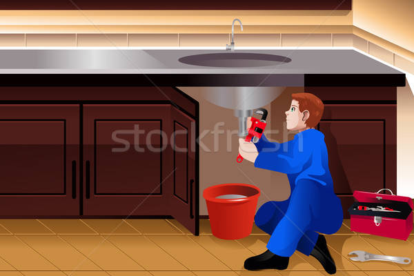 Plumber fixing a leaky faucet Stock photo © artisticco