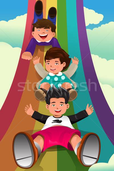 Children sliding down the rainbow Stock photo © artisticco