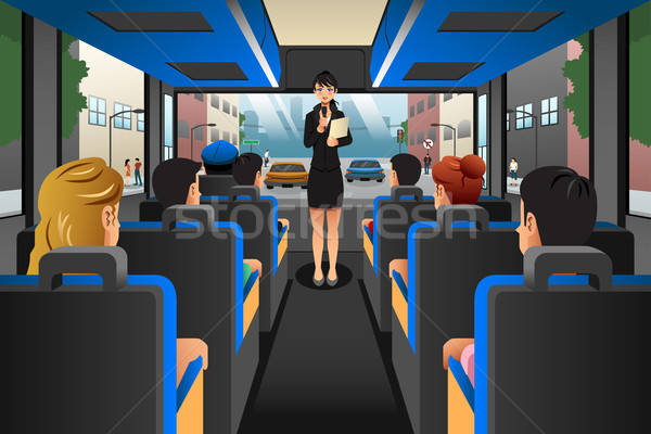 Tour guide talking to tourists in a tour bus Stock photo © artisticco