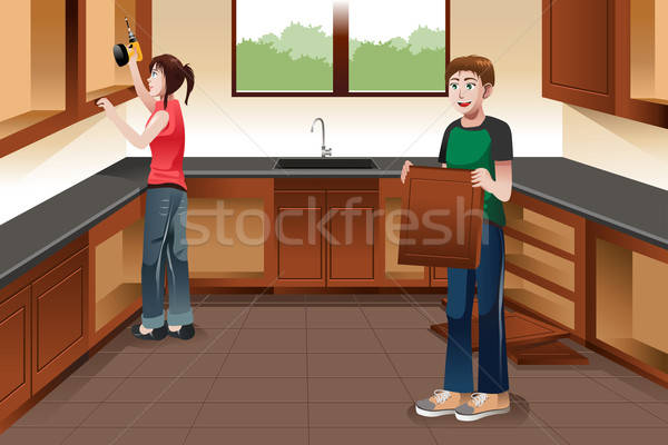 Young couple installing kitchen cabinets Stock photo © artisticco