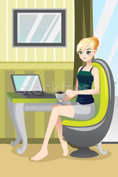 Nő otthon laptopot használ iszik kávé számítógép Stock fotó © artisticco
