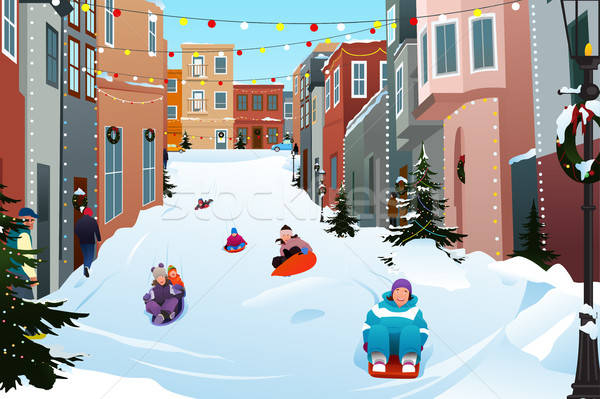 Kids Sledding on a Snowy Street During Winter Season Stock photo © artisticco