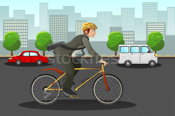 Businessman biking in the city Stock photo © artisticco