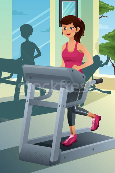 Woman running on a treadmill in a gym Stock photo © artisticco
