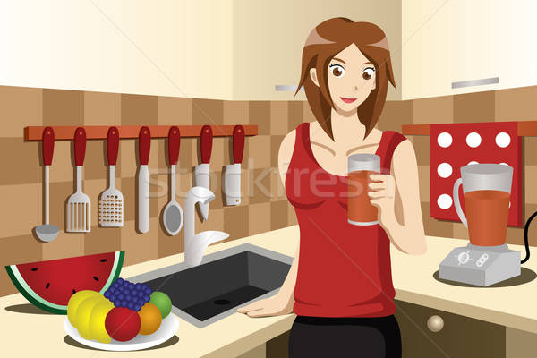 Stock photo: Healthy woman drinking fruit juice