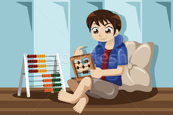 Kid playing with abacus Stock photo © artisticco