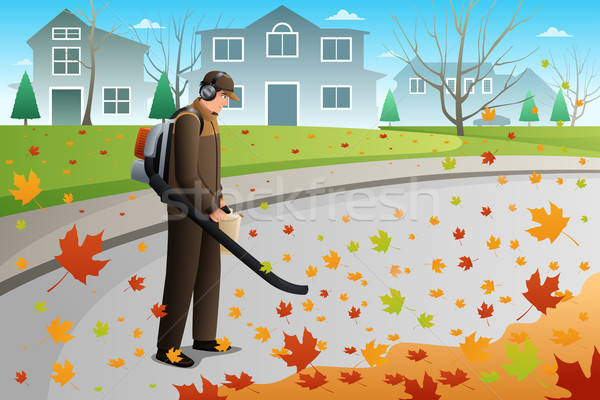 Férfi tiszta felfelé levelek őszi szezon fúvó Stock fotó © artisticco