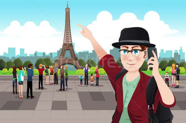 Tourist Taking Picture Near Eiffel Tower Stock photo © artisticco