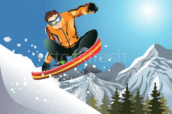Snowboarder azione uomo neve montagna inverno Foto d'archivio © artisticco