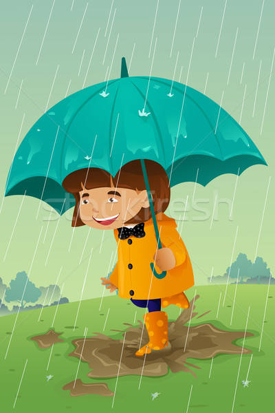 Girl with umbrella and raincoat playing in the mud Stock photo © artisticco