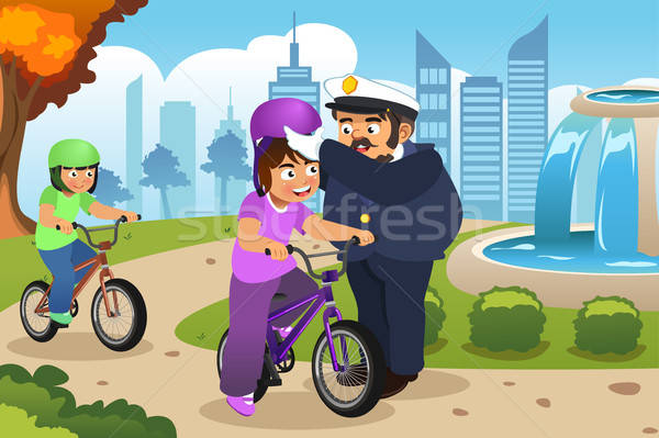 Police Officer Putting on Helmet on a Kid Riding a Bike Stock photo © artisticco