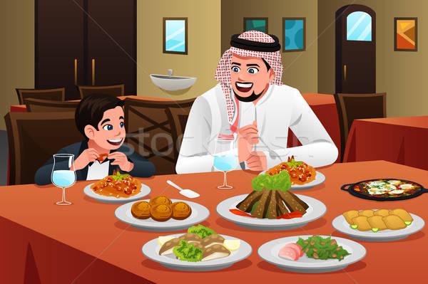 Muslim Arabian Man Eating With His Son Stock photo © artisticco