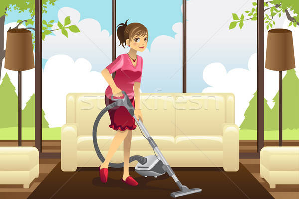 Housewife vacuuming carpet Stock photo © artisticco
