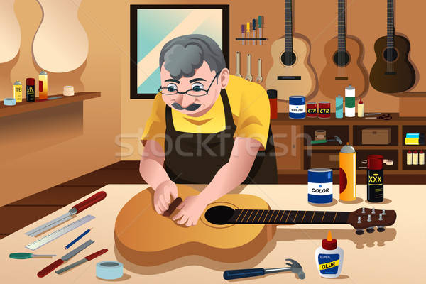 Guitar maker working in his shop Stock photo © artisticco