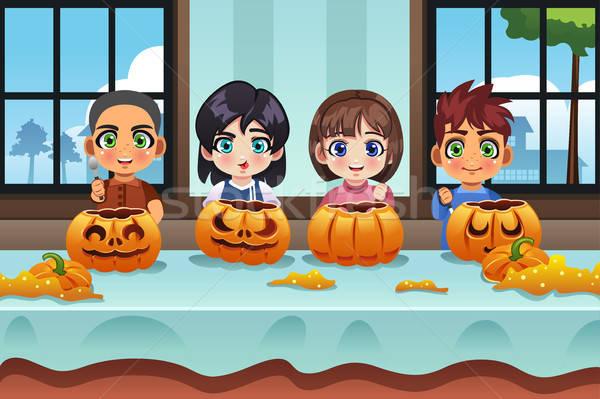 Kids Carving Pumpkin Stock photo © artisticco