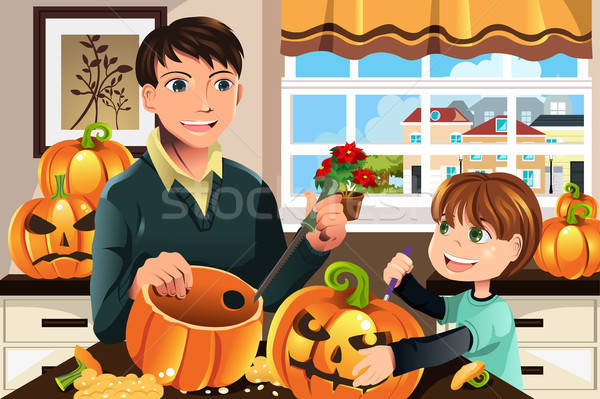 Father and son carving pumpkins Stock photo © artisticco