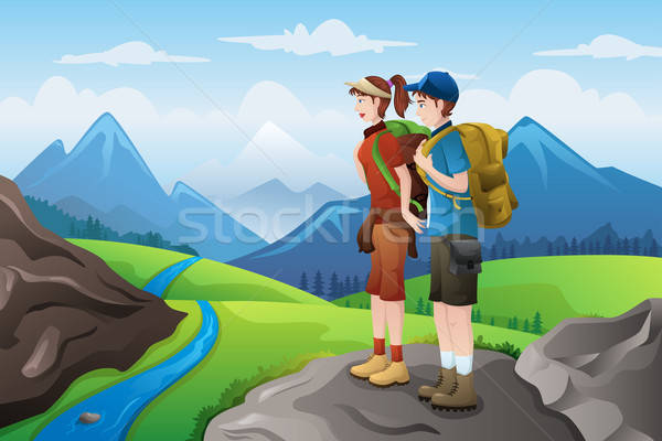 Backpackers on top mountains Stock photo © artisticco