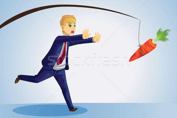 Empresário cenoura alcançar vara negócio executivo Foto stock © artisticco