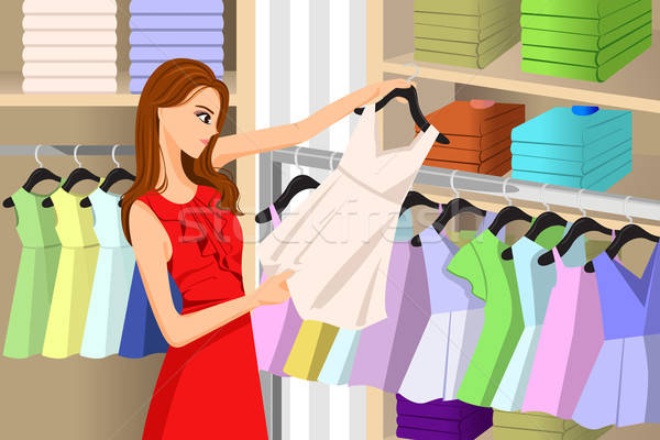 Girl Buying Clothes at a Store Stock photo © artisticco