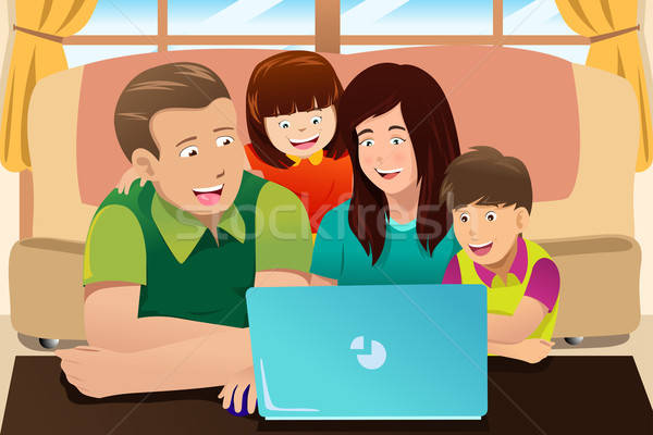 Happy family looking at a laptop Stock photo © artisticco