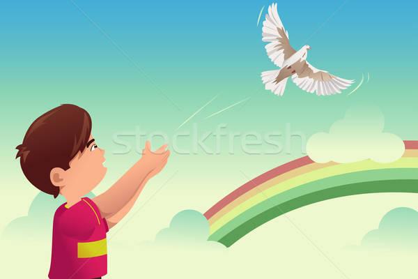 Kid release a bird Stock photo © artisticco