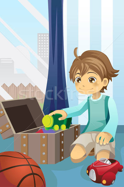 Boy cleaning up his toys Stock photo © artisticco
