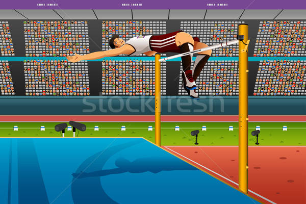 Stock photo: Male high jumper in midair over bar