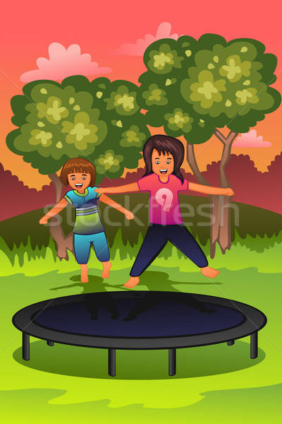 Happy kids playing on a trampoline Stock photo © artisticco