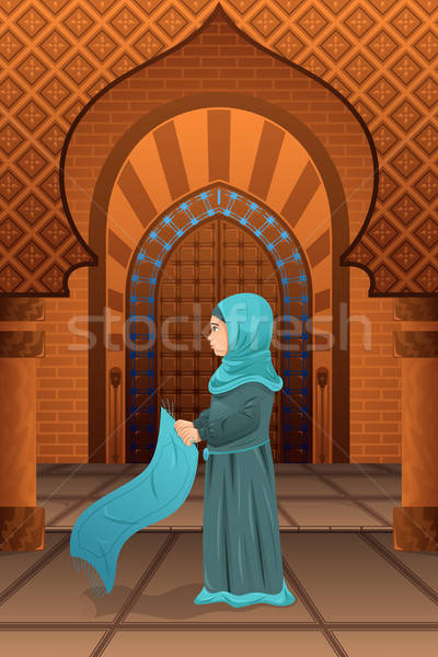 Muslim woman praying in the mosque Stock photo © artisticco