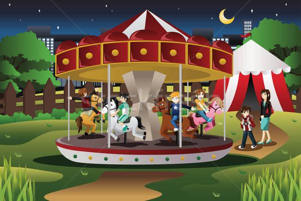 Kids on Merry Go Round Stock photo © artisticco