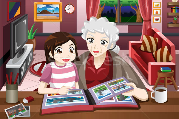 Abuela nieta mirando Foto álbum mujer Foto stock © artisticco