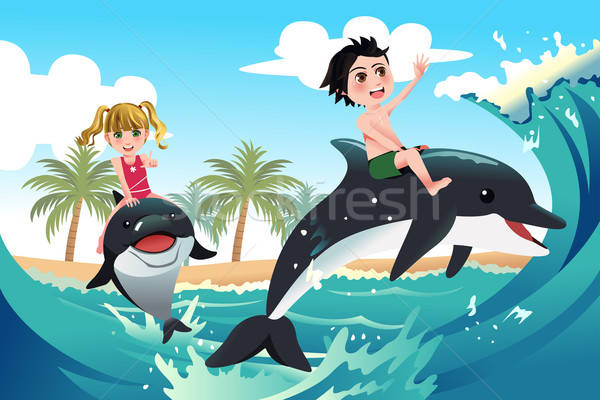 Happy children playing with dolphins in the ocean Stock photo © artisticco