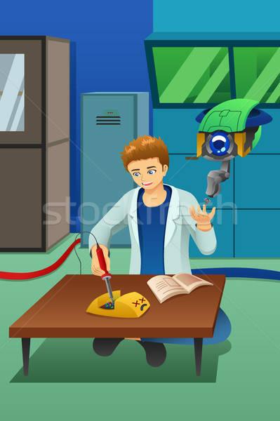 Homem trabalhando eletrônico dispositivo robô ajudar Foto stock © artisticco