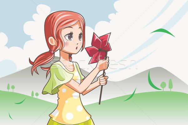 Girl blowing pinwheel Stock photo © artisticco