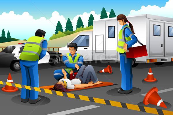 фельдшер помочь раненый девушки аварии человека Сток-фото © artisticco