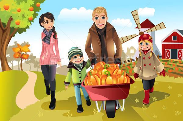 Family doing pumpkin patch Stock photo © artisticco