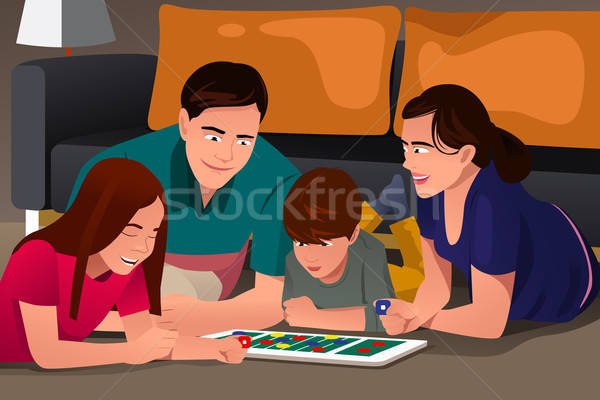 Family Playing a Board Game Stock photo © artisticco