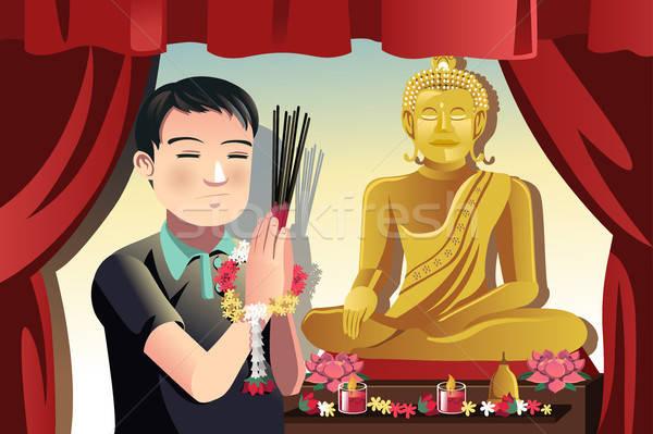 Budista homem oração templo adorar sozinho Foto stock © artisticco