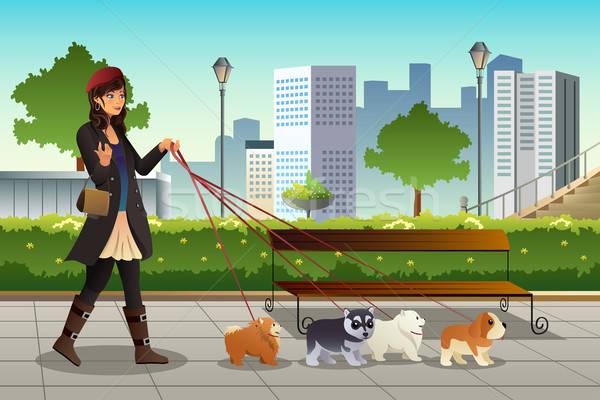 женщину ходьбе собаки красивая женщина город девушки Сток-фото © artisticco