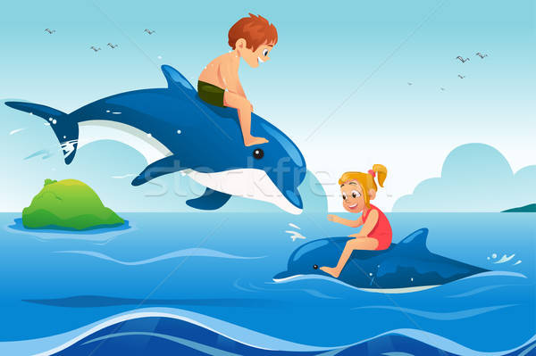 Little Kids Swimming with Dolphins in the Ocean Stock photo © artisticco