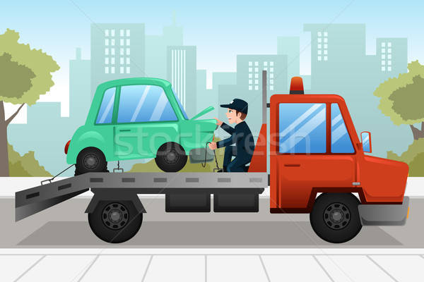Tow truck towing a broken down car Stock photo © artisticco