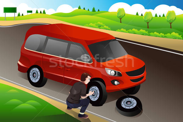 Man changing flat tire Stock photo © artisticco