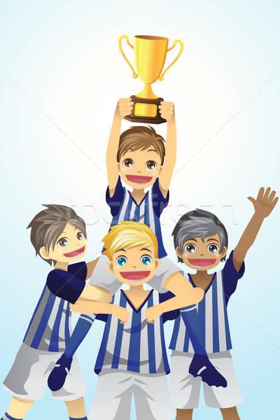 Sport kids lifting trophy Stock photo © artisticco