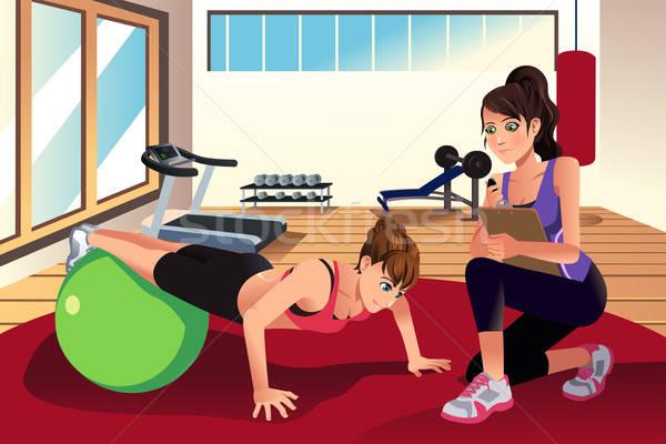 Kadın personal trainer eğitim kadın spor salonu uygunluk Stok fotoğraf © artisticco