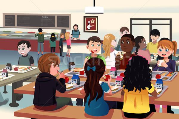 Enfants manger école cafétéria filles adolescents Photo stock © artisticco
