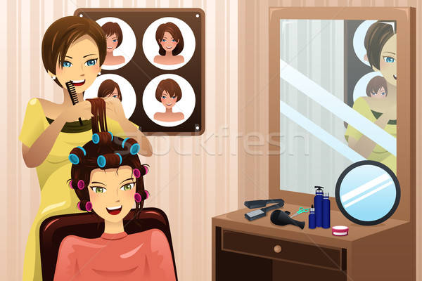 Hairstylist working in a salon Stock photo © artisticco