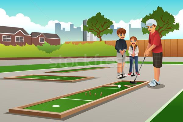 Kids Playing Mini Golf Stock photo © artisticco