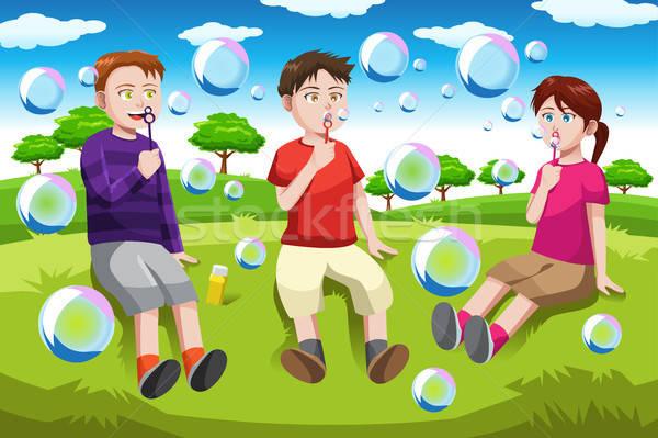 Gyerekek buborékfújás boldog park gyerekek fű Stock fotó © artisticco