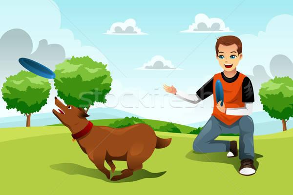 человека играет Фрисби собака молодым человеком парка Сток-фото © artisticco
